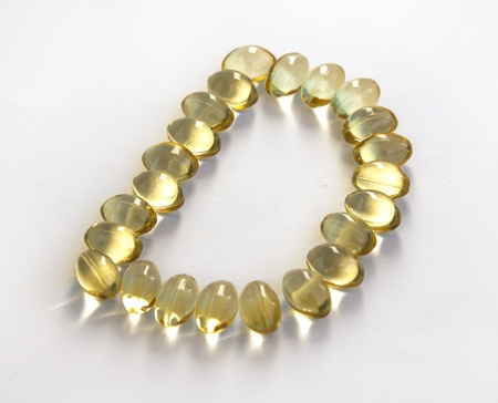 Vitamin D capsules forming the letter D - Ultimate Health Personal Trainer Toluca Lake