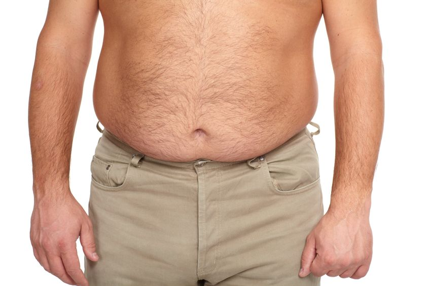 Shirtless over weight man - muffin top.