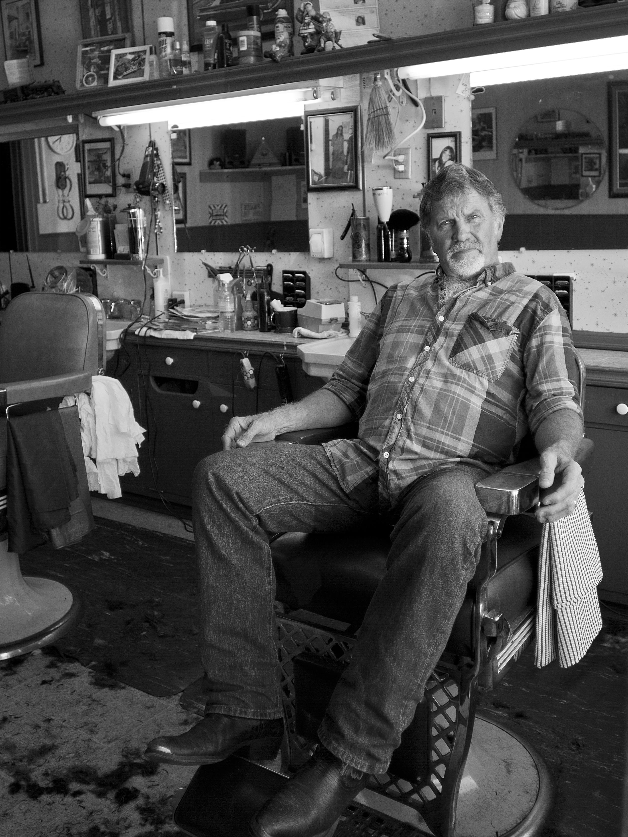 Mike. Head barber/owner of Sandy's Barber Shop. Bainbridge Island.