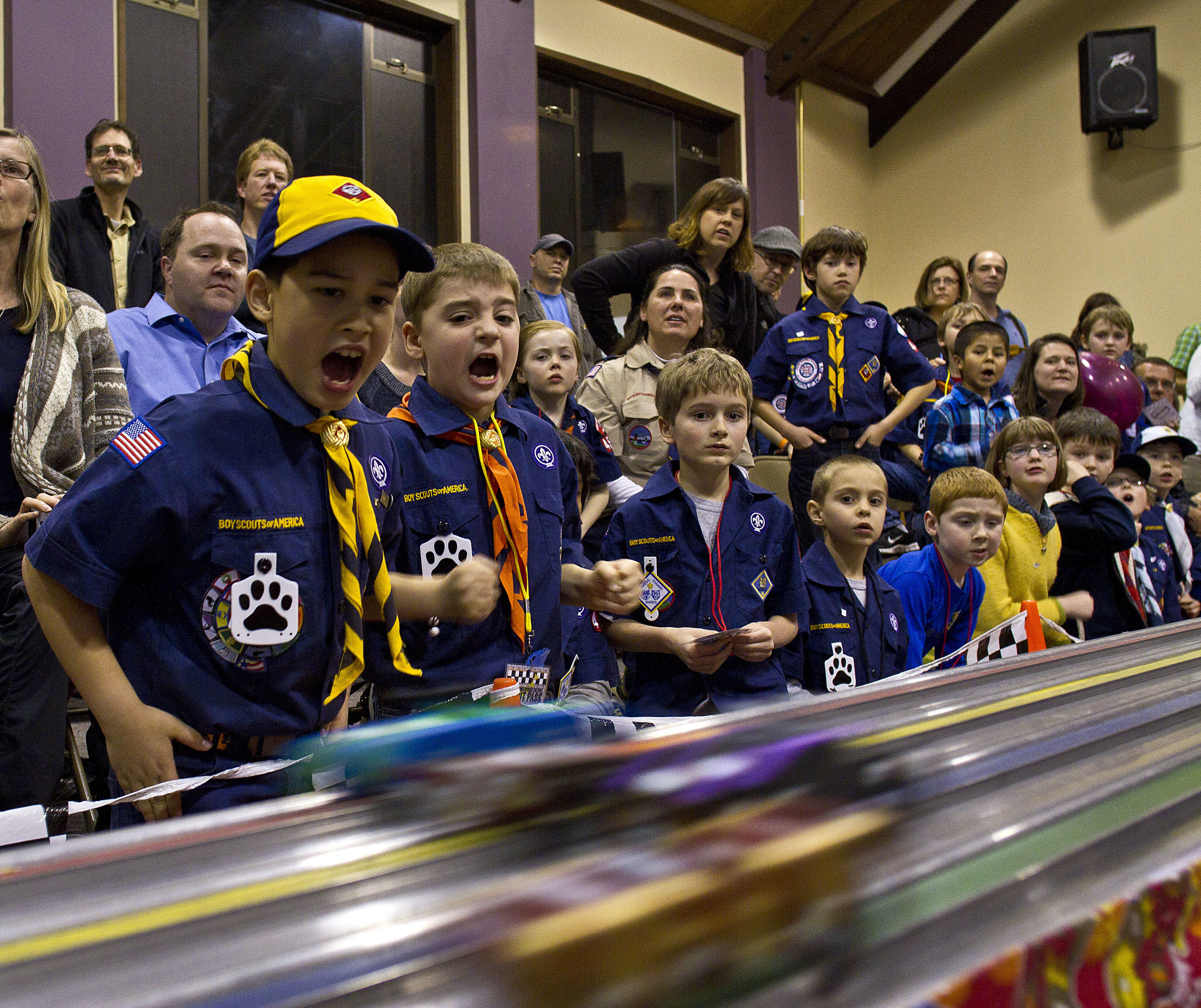 Cub scouts cheer at an annual pine wood derby racing event on Bainbridge Island.