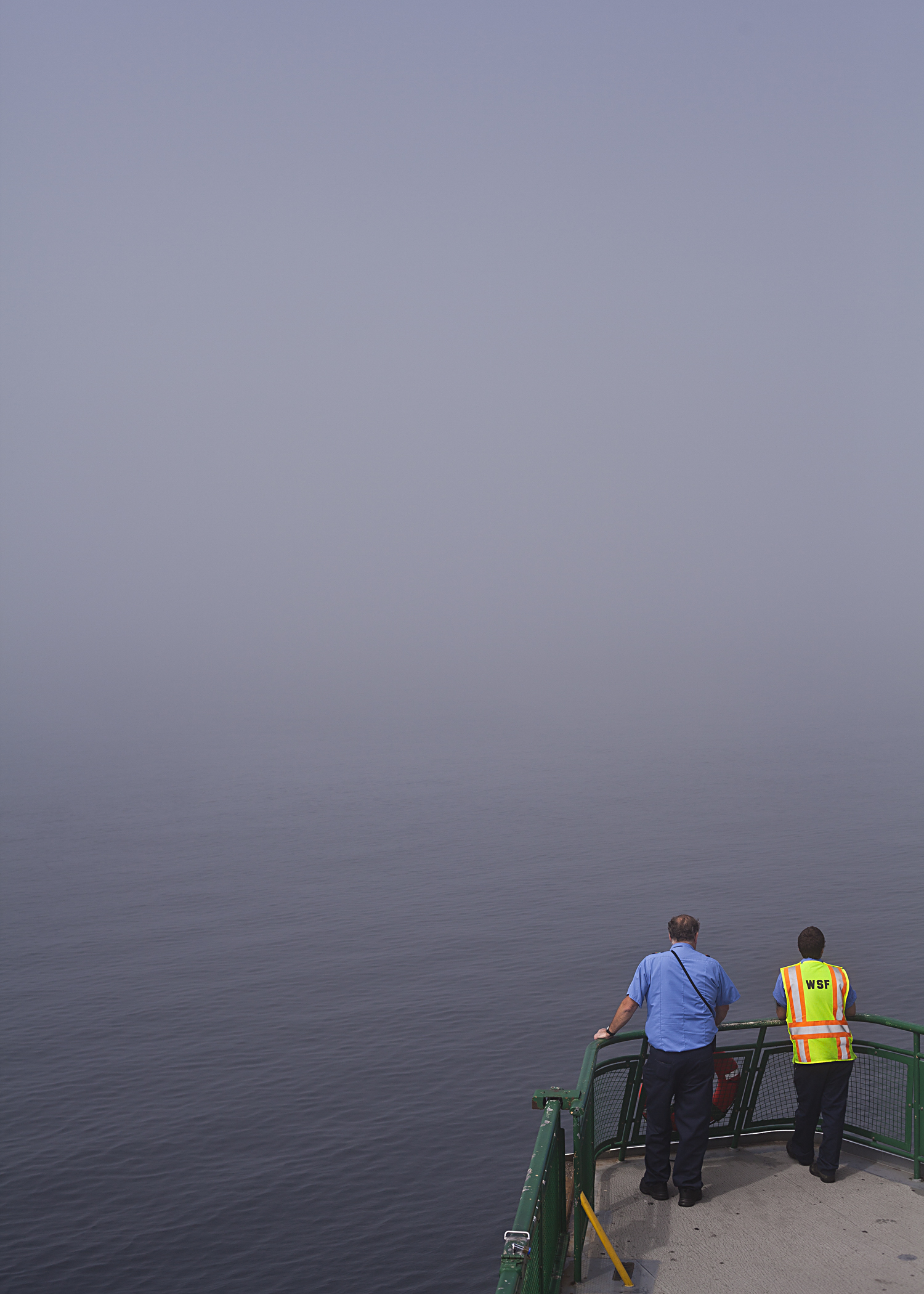 Extreme fog slows the passage of the Washington State ferry during an afternoon sailing from Seattle to Bainbridge Island.
