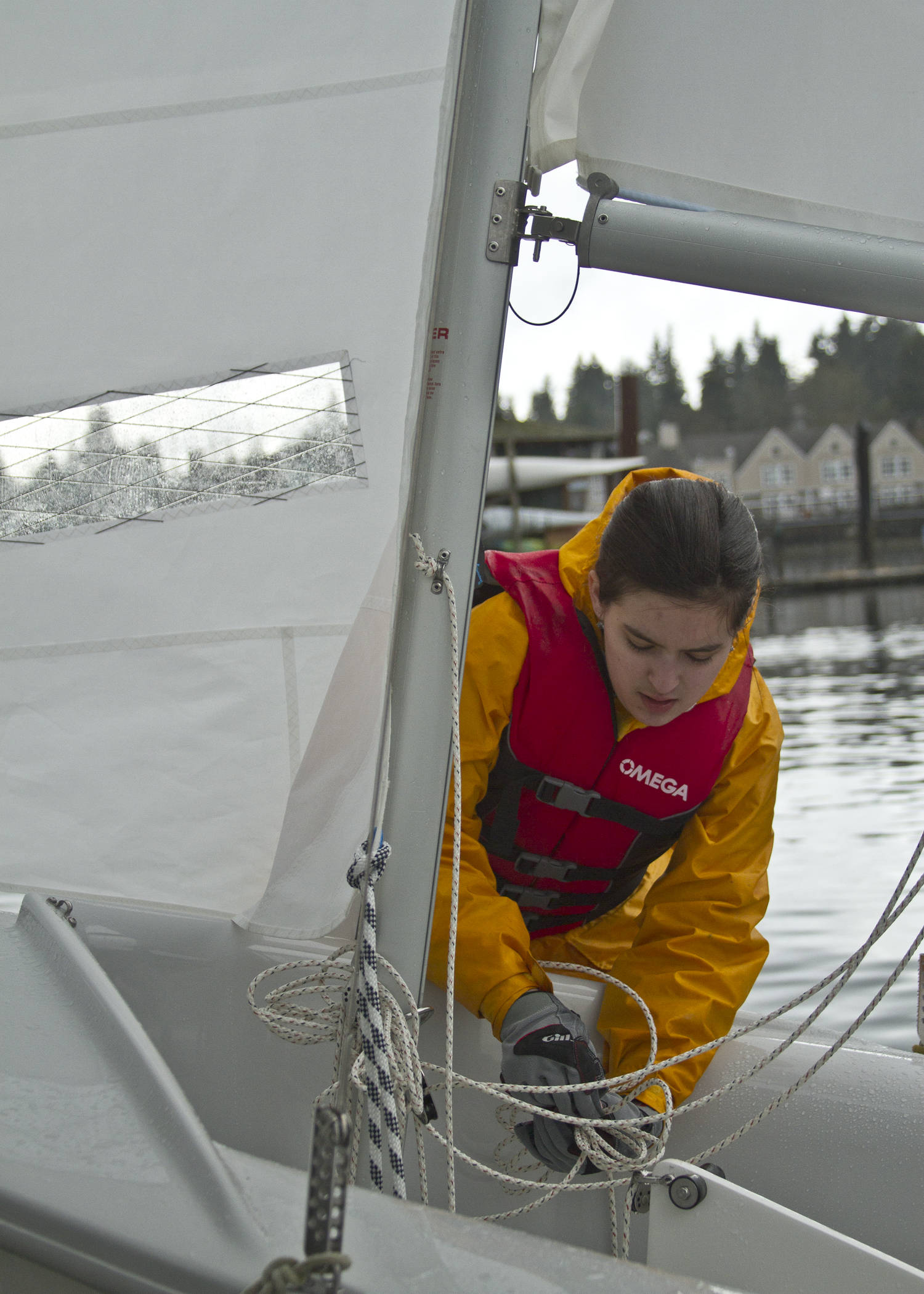 Bainbridge High School freshman sailor Diana Curtis prepares her boat to be put into the water during the team's second practice session of the 2013 season.