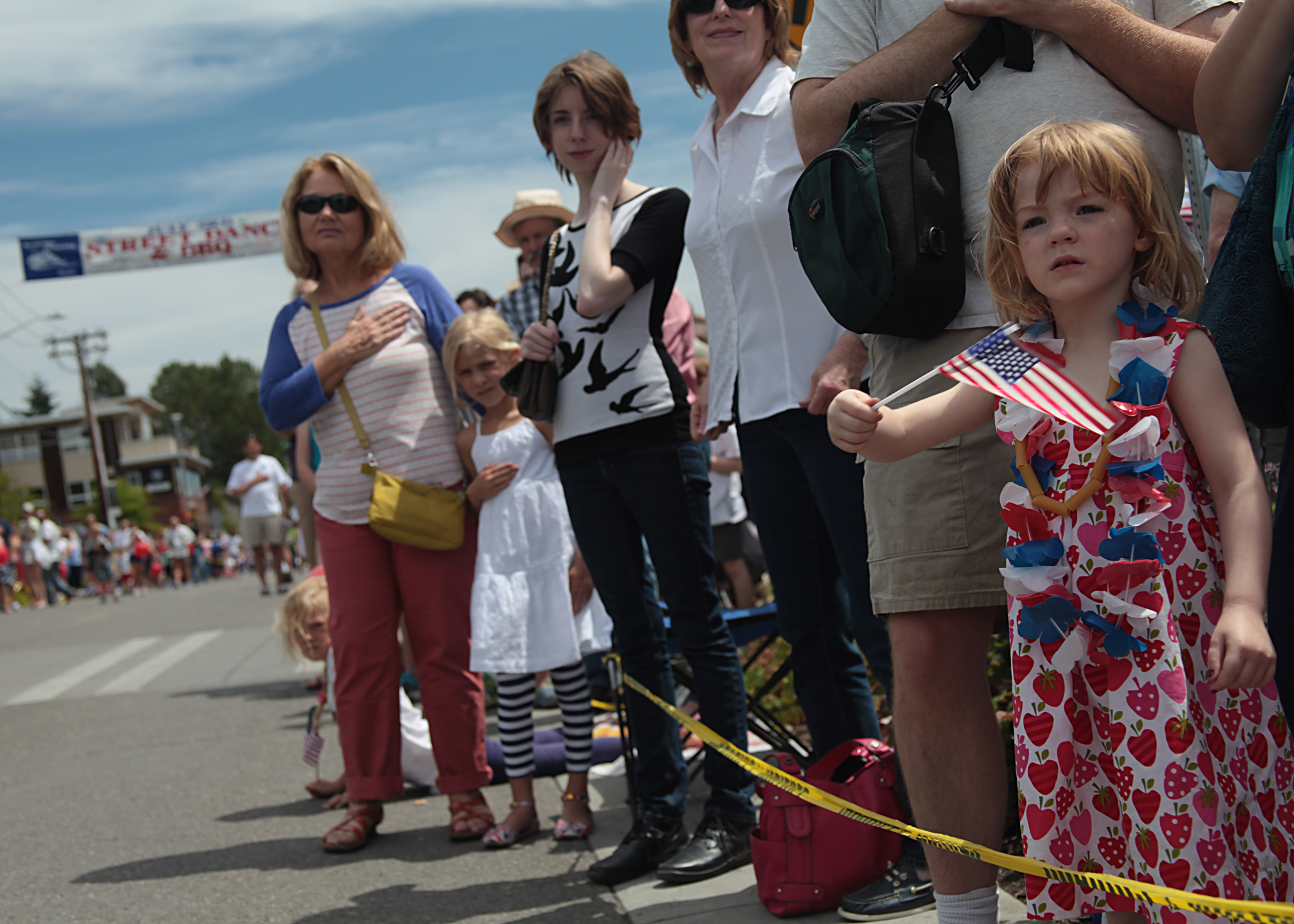 A crowd lines the streets of downtown Winslow just prior to the start of the 2014 Grand Old Fourth of July parade on Bainbridge Island.