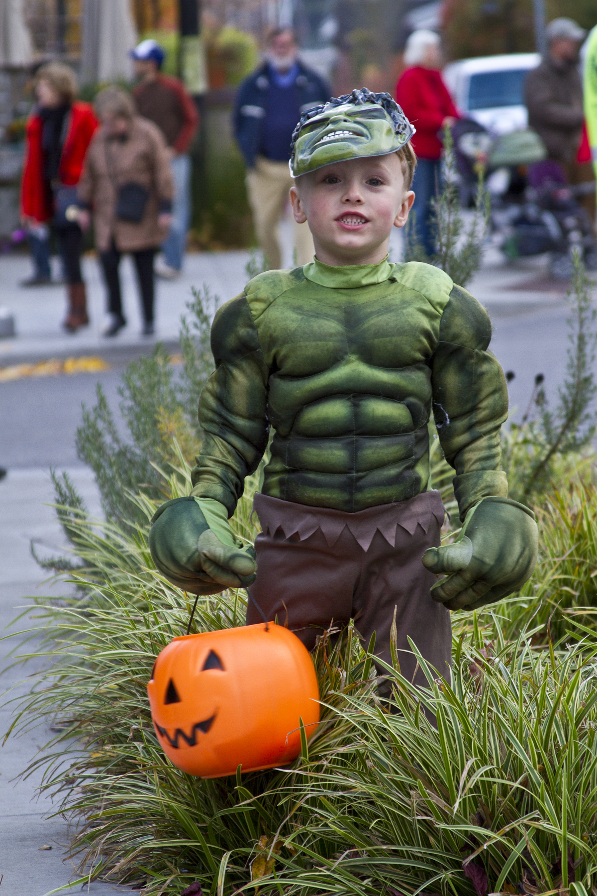 One young trick-or-treater, dressed as the Incredible Hulk, takes a quick break to pose during the 2013 downtown Winslow Trick Or Treat event on Bainbridge Island.