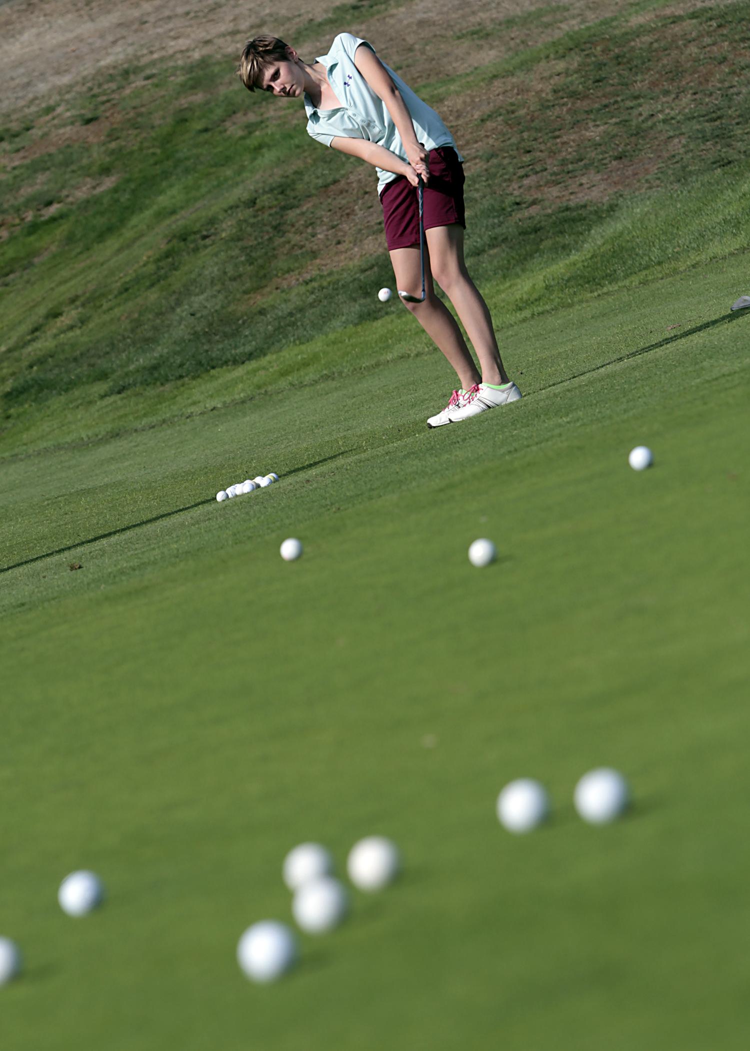 Bainbridge High Schooljunior and girls golf team captain Claire Lunzer works through a preseason practice session.