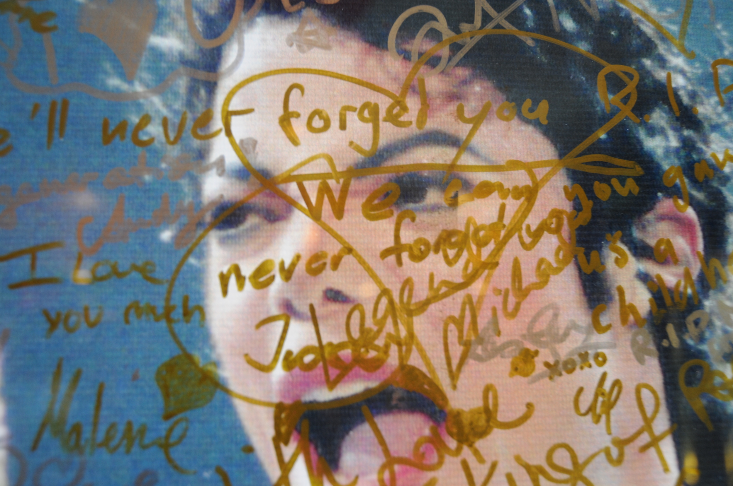 A poster outside of a Hard Rock Cafe in Singapore, marked with the memorial messages of fans.