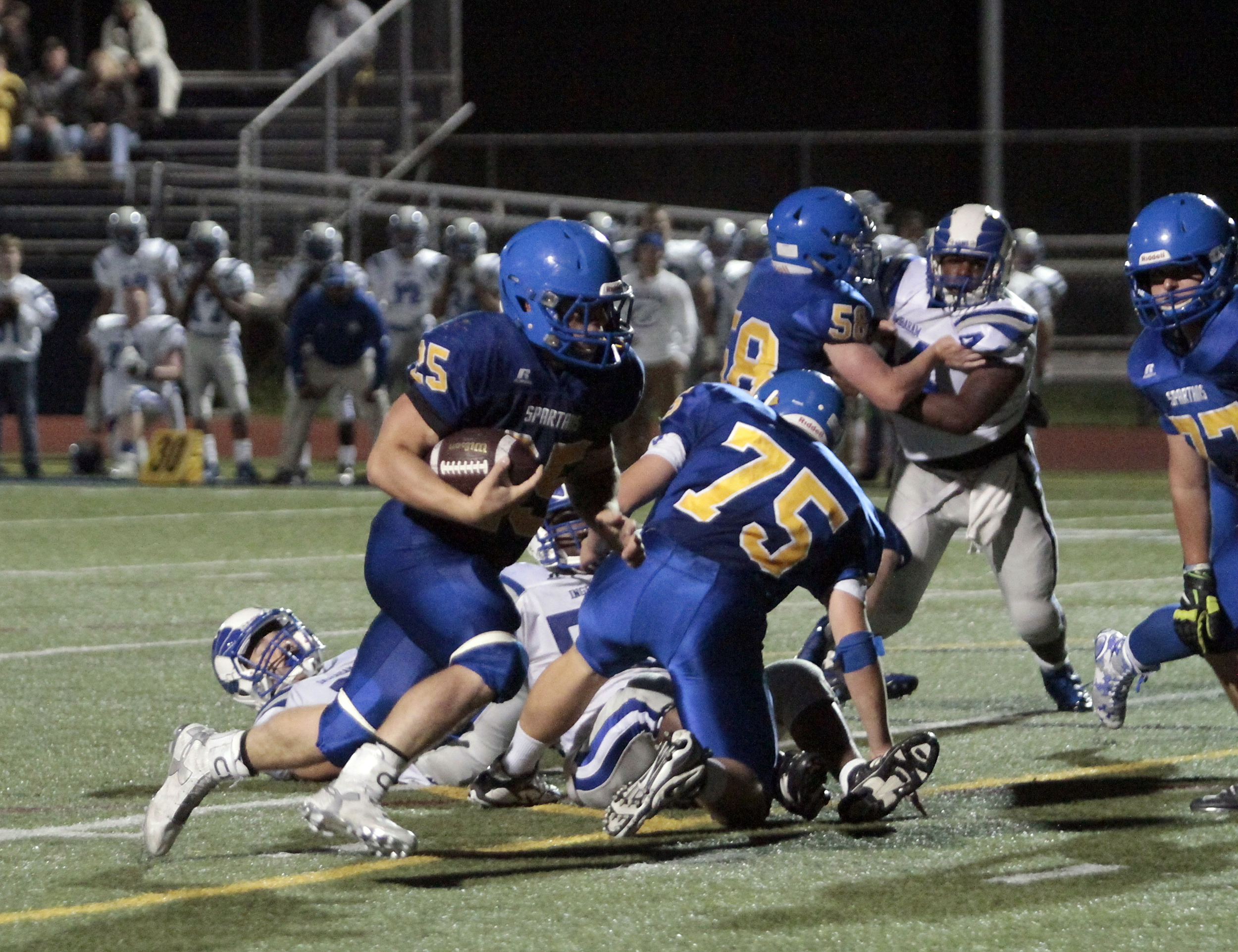 Bainbridge running back/linebacker Sam Wysong plows through the line at home against Ingraham. The senior Spartan gave a stellar early season performance, managing two touchdowns, 23 for 120 yards rushing and one reception for 23 yards.