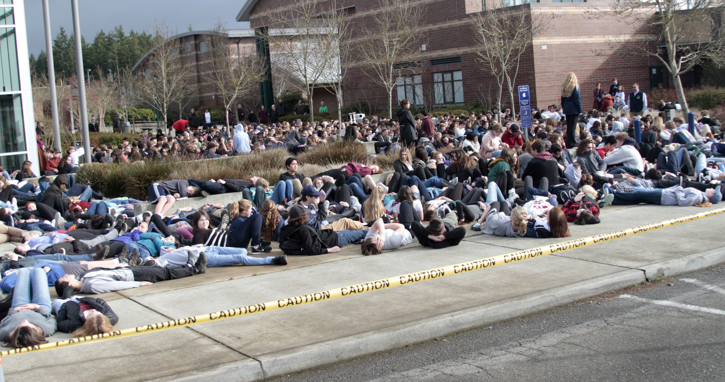 "Hundreds of students from Bainbridge and Eagle Harbor high schools conduct a ""die-in,"" as part of a symbolic walk out Wednesday, March 14, 2018, part of a protest by students around the nation calling for improved campus safety in the wake of regular mass shootings."