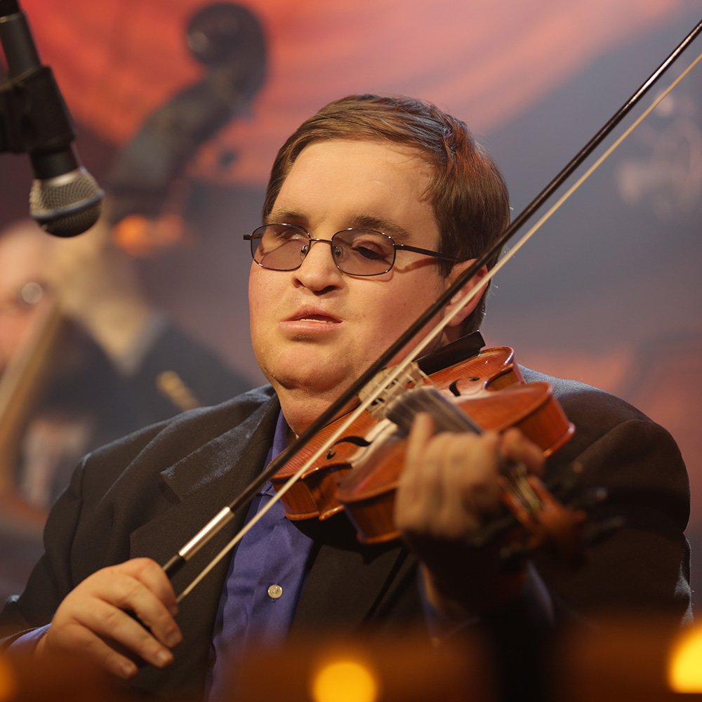 Michael Cleveland - Michael Cleveland is considered one of the premier bluegrass fiddlers of his generation, Mike picked up a fiddle at age four, and his talent was recognized early.