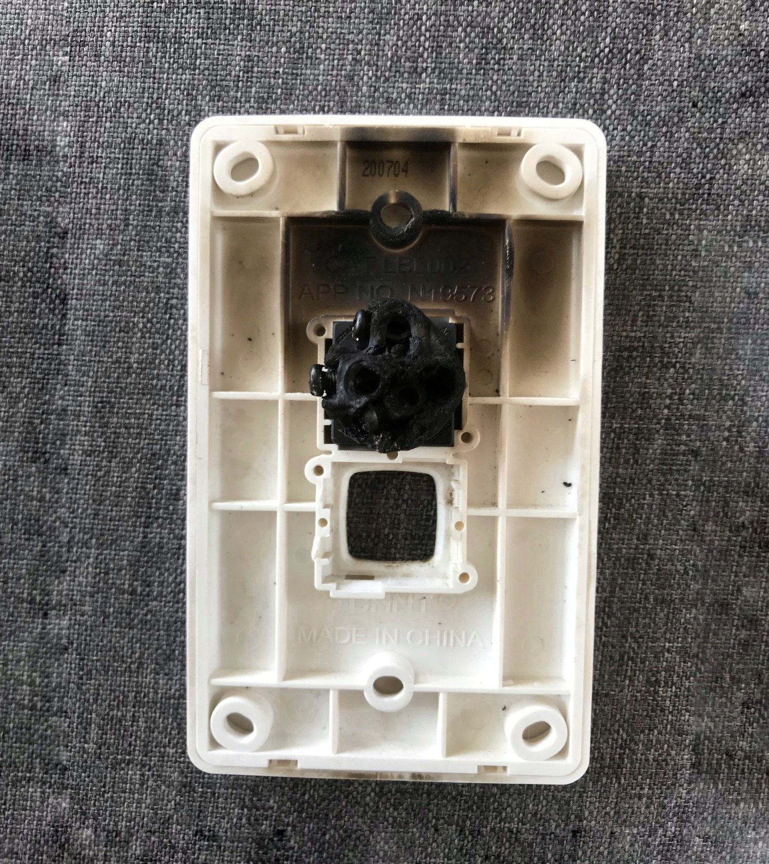 The customer's damaged electrical switch, which almost led to a house fire.