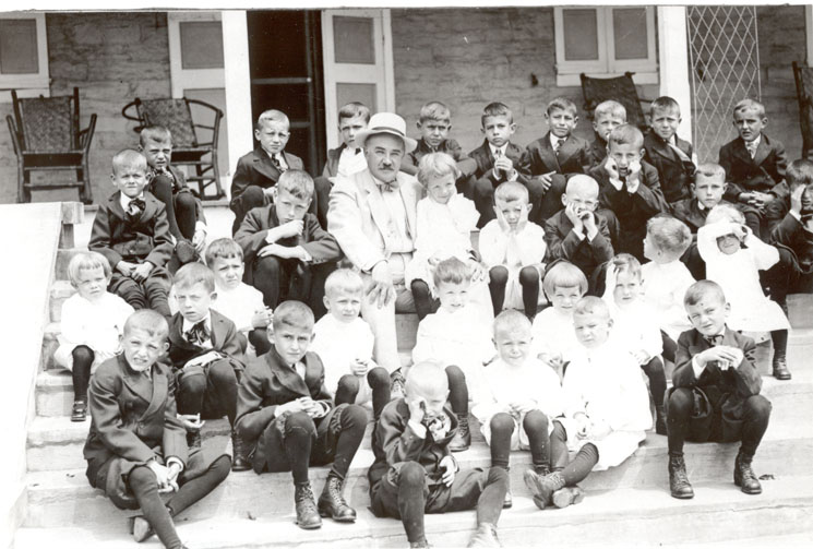 Mr. Hershey and his first boys, 1910.