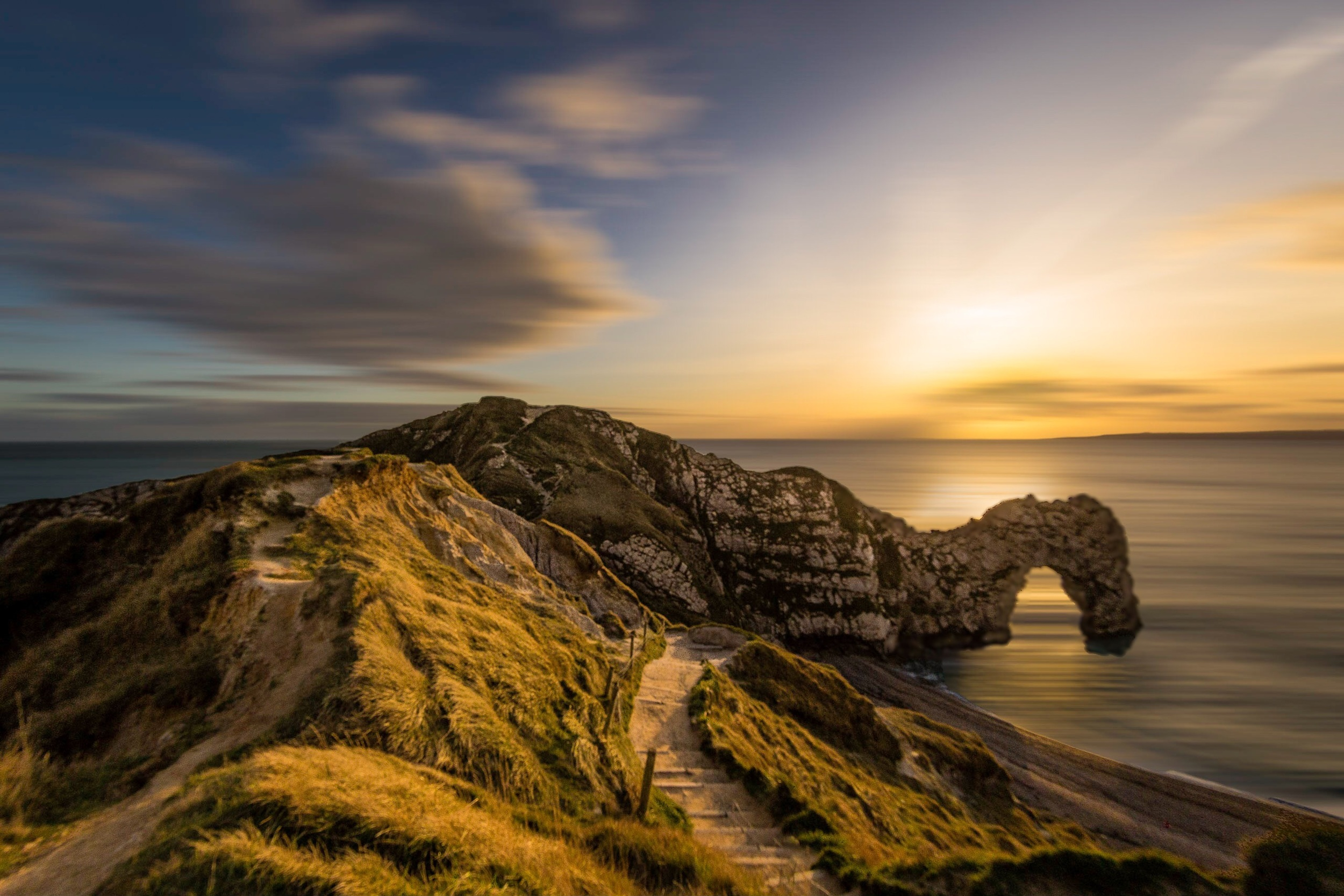 Durdle Door  This really is a world famous landmark, photographed one cold winters evening when there was absolutely no-one there but me. A great subject, a great sky, still clouds and moving water all combine to produce this slightly different picture of Durdle Door.