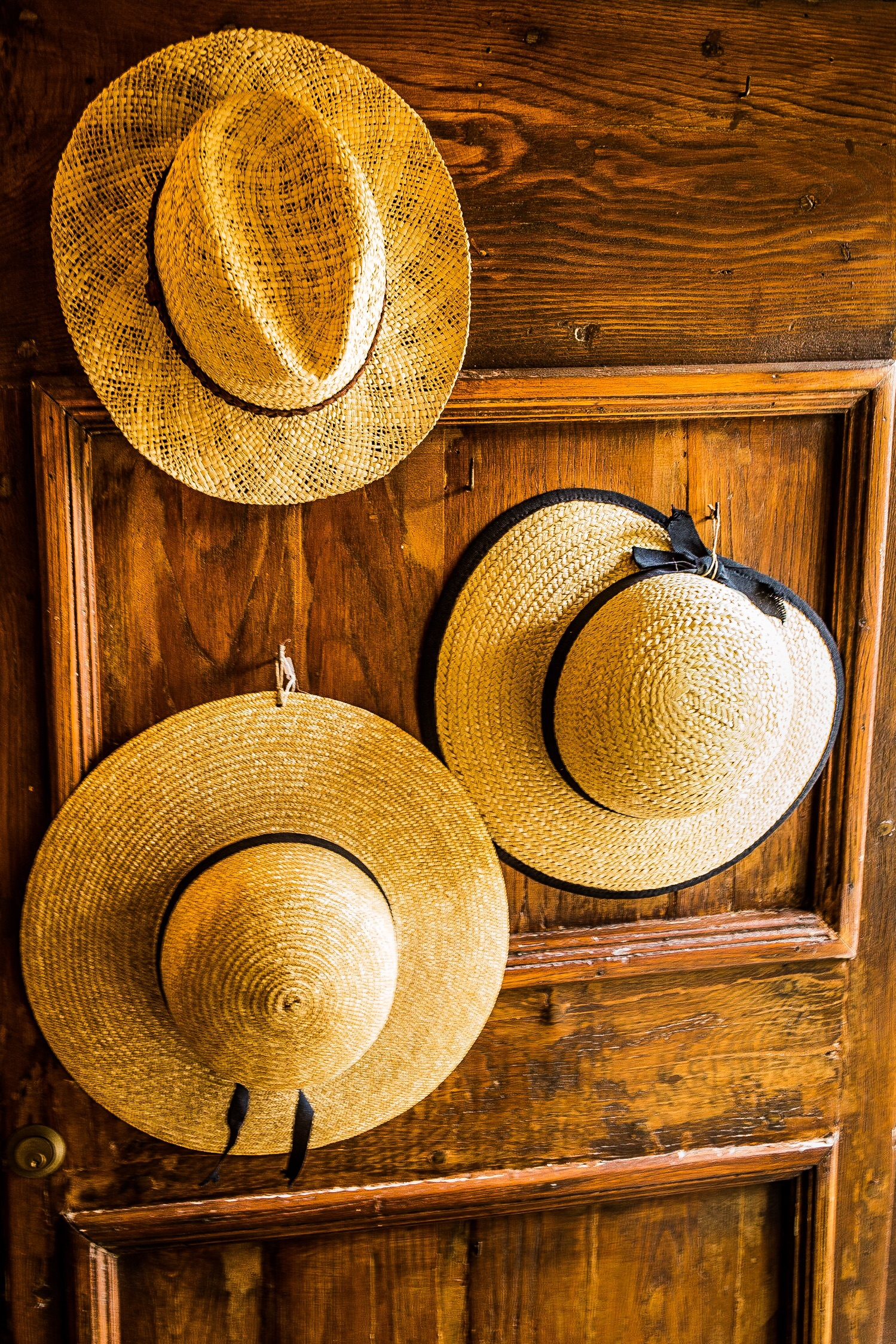 Hats on a door, Italy by Rick McEvoy travel photographer