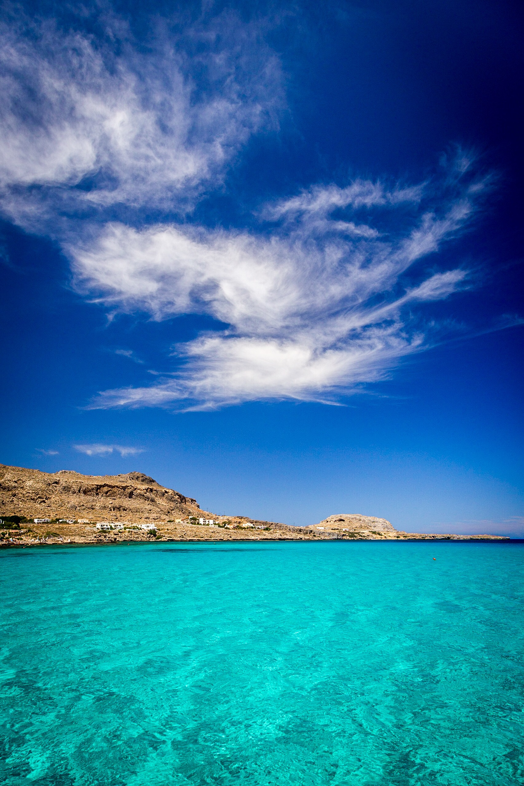 The aquamarine sea in Navarone Bay, Rhodes, Greece, by Rick McEvoy landscape photographer
