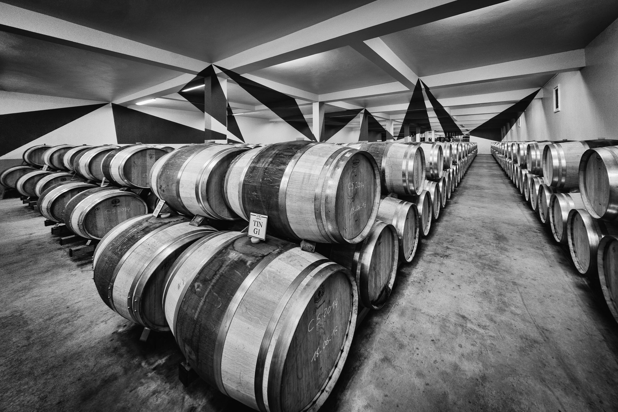 An unusual piecee of interior photography work - a barrel store full of wine and art!