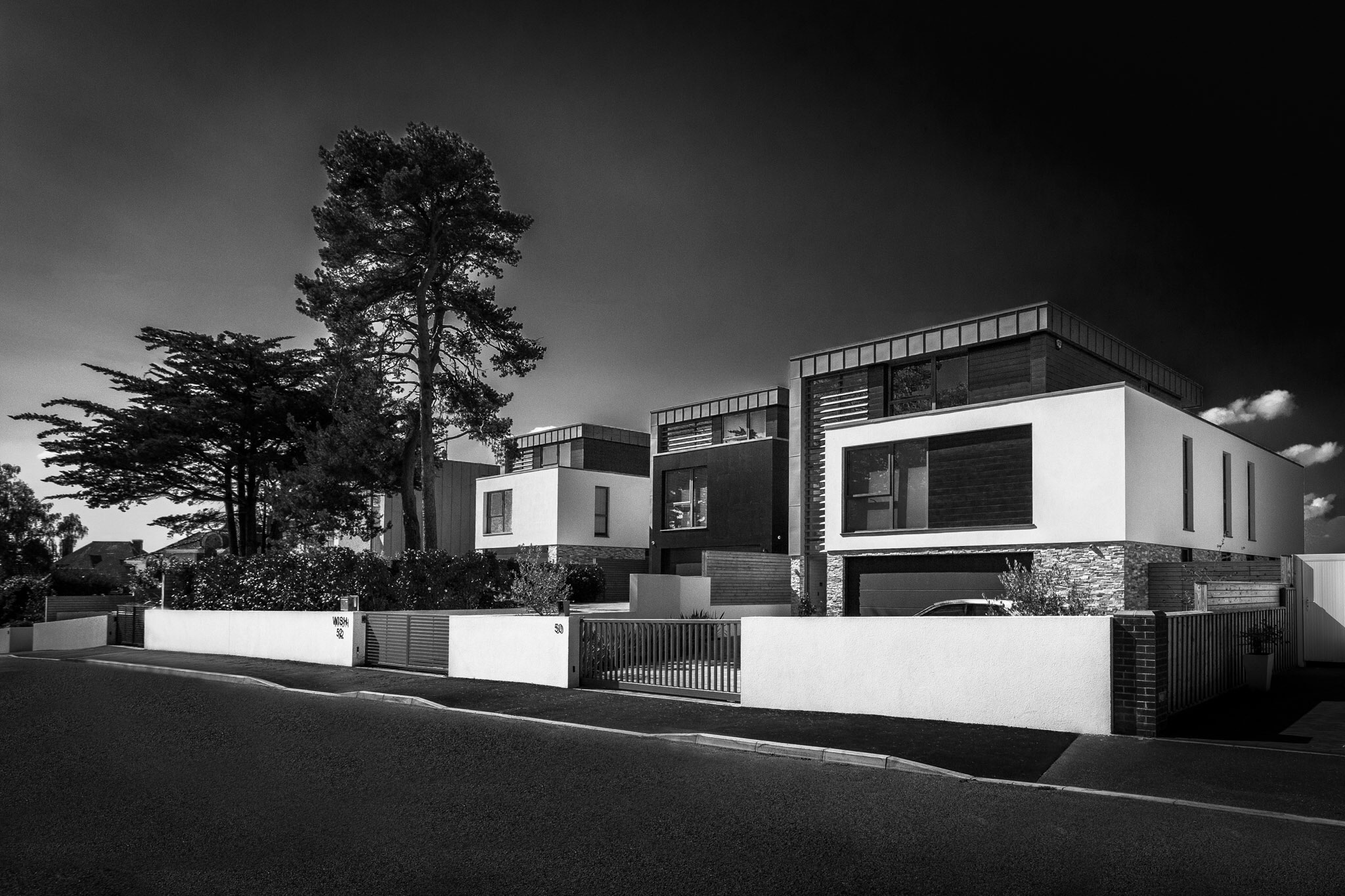 Render to new buildings by construction photographer Rick McEvoy