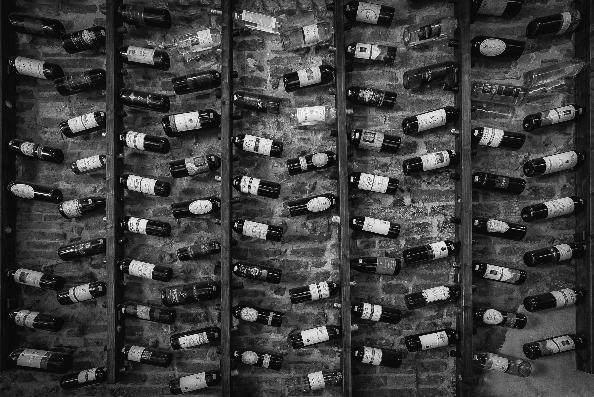 Picture of a wine rack in a restaurant in Lucca, Italy