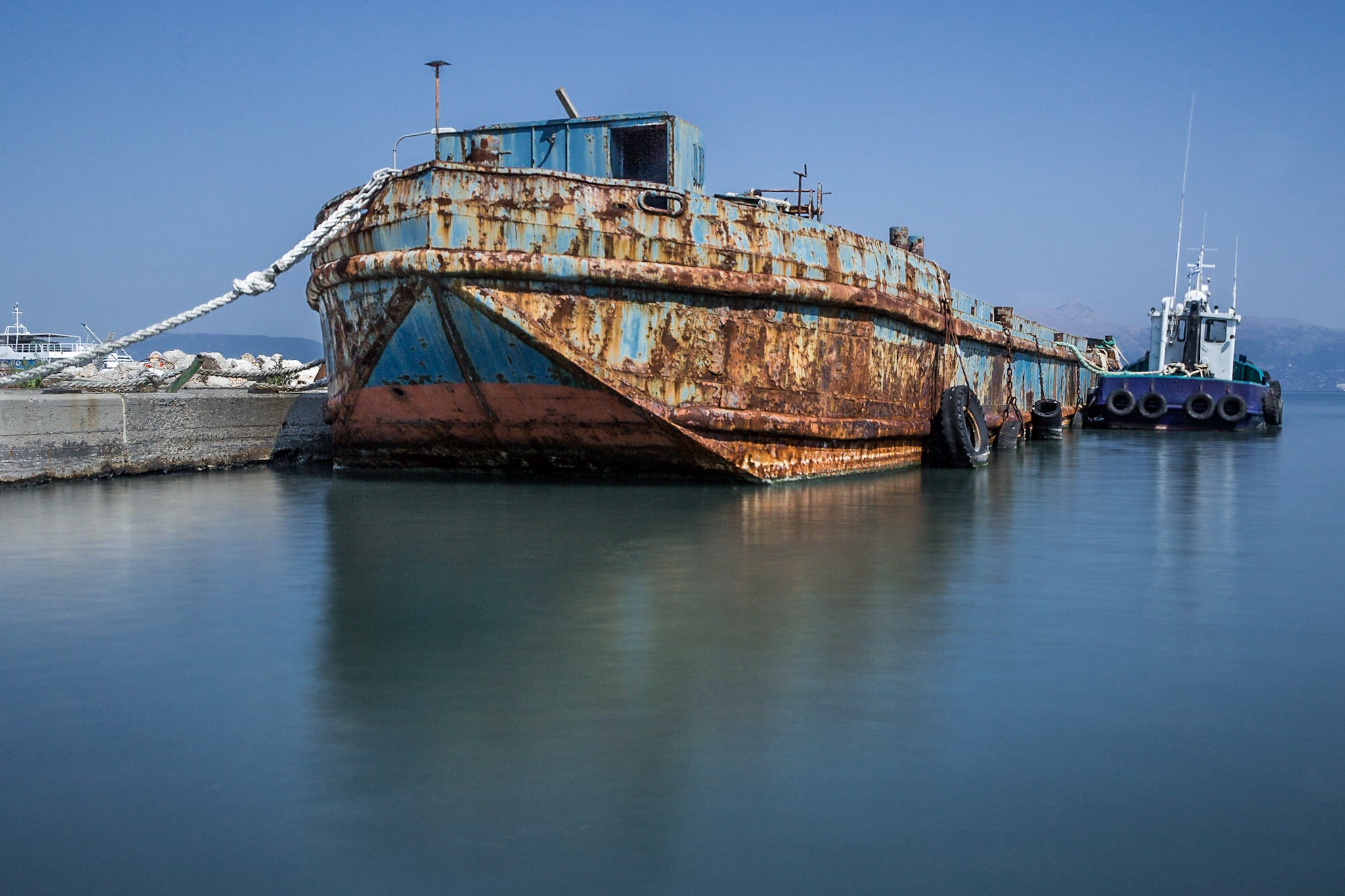 Picture of a rusty boat in the port in Corfu Town by Rick McEvoy industrial photographer
