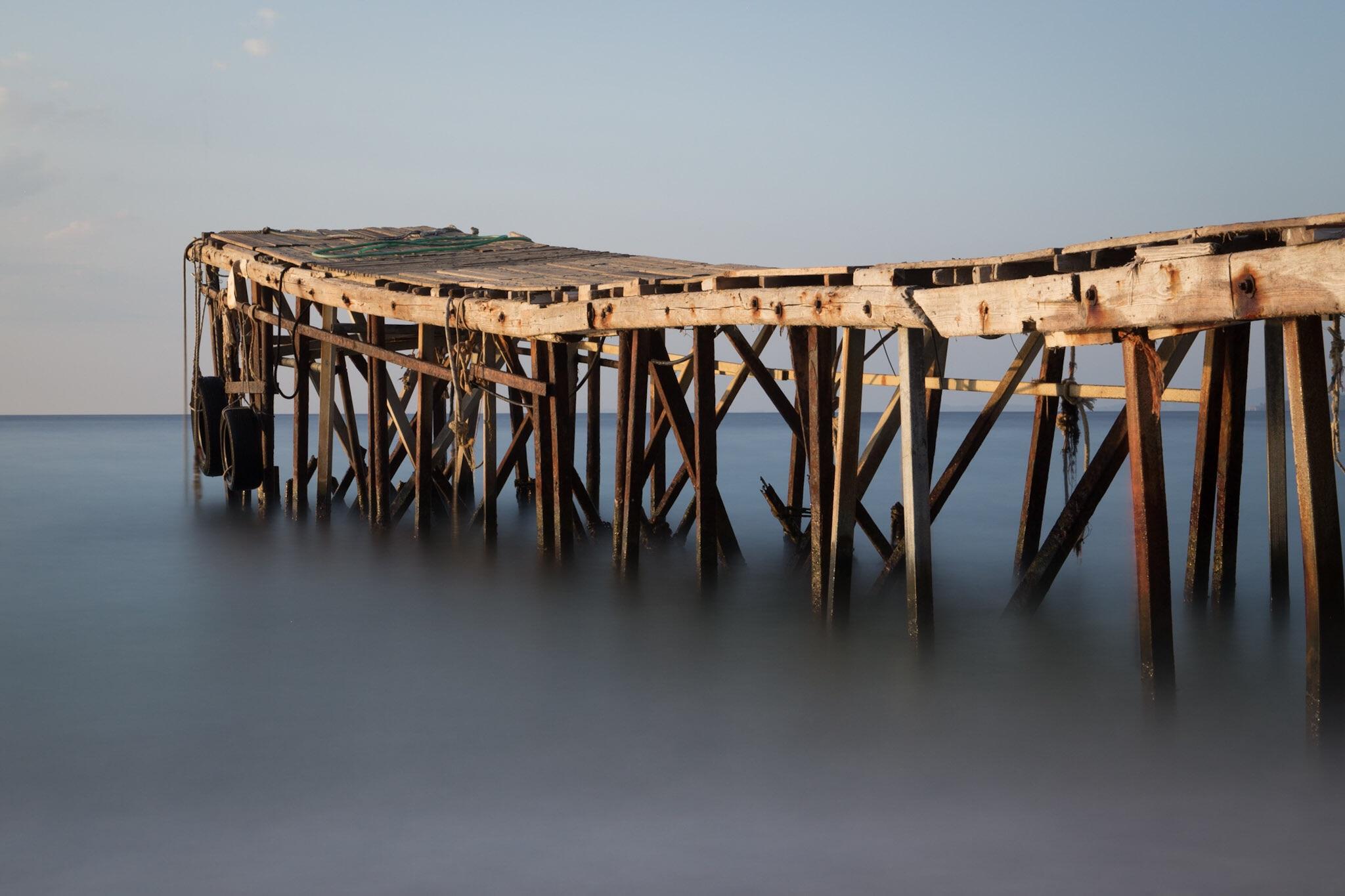 Picture of the wooden jetty, Nissaki Beach, Corfu, Greece