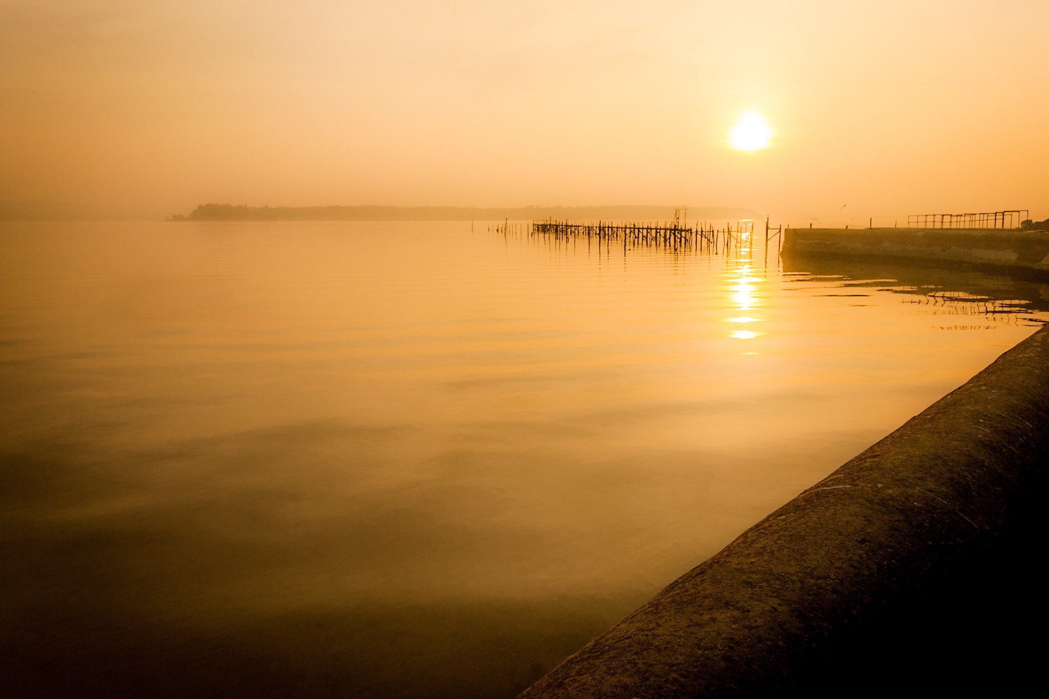 A lovely warm glowing sunset picture of Sandbanks in Dorset