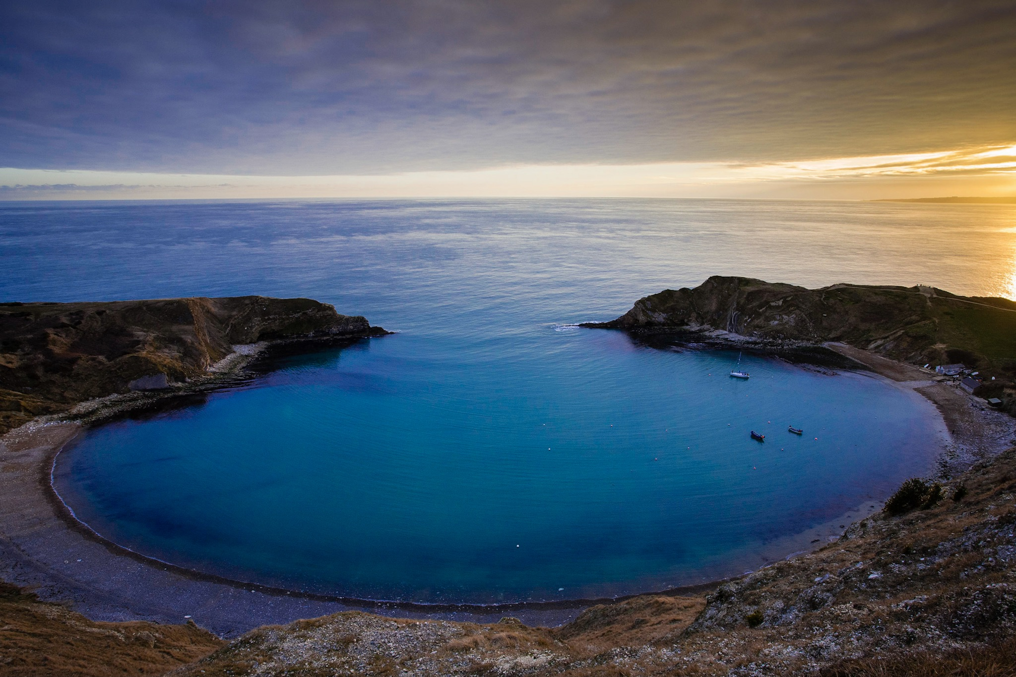 The picture of Lulworth Cove at sunset.