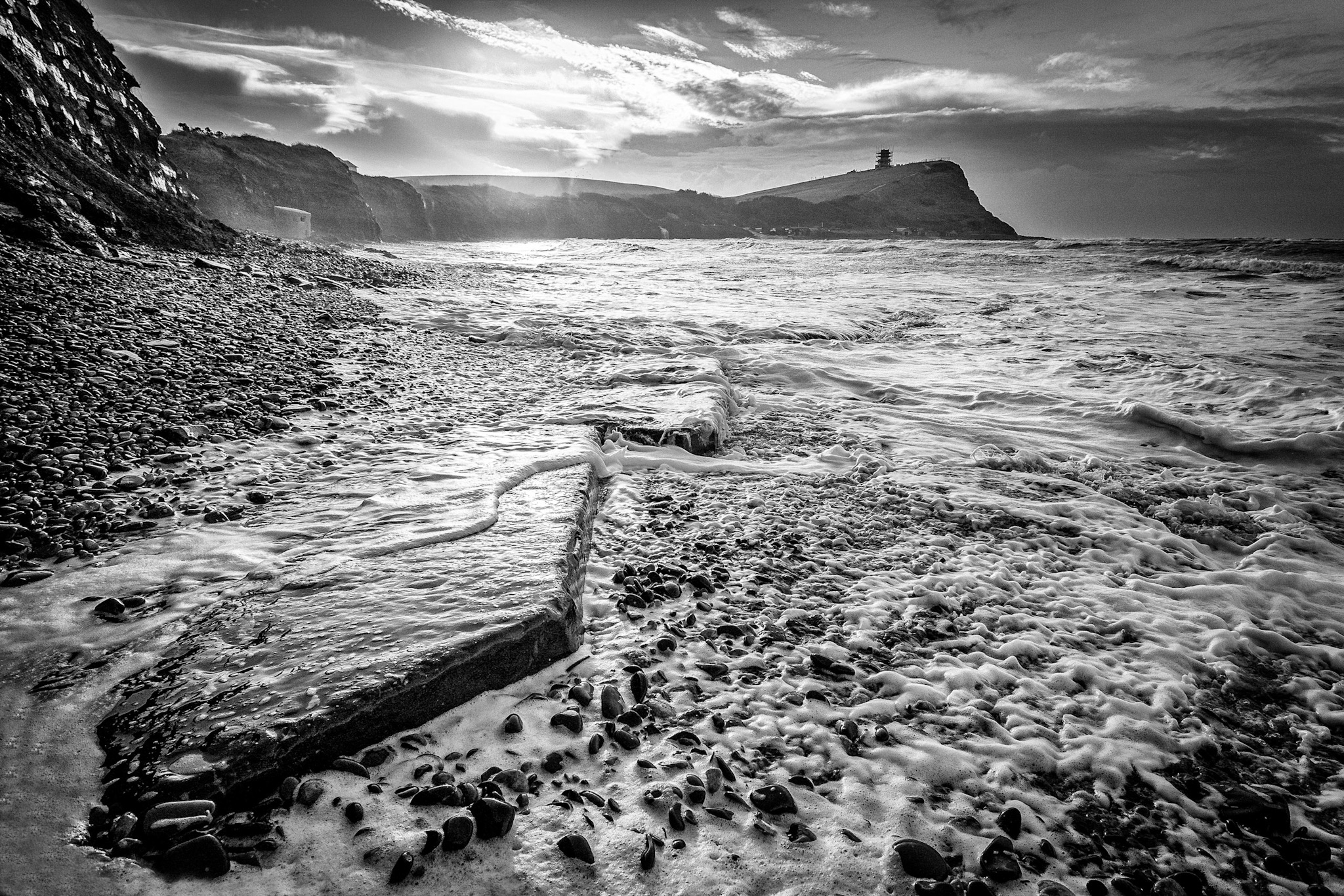 Picture of Kimmeridge Bay at sunrise in black and white