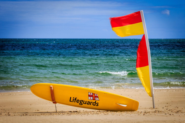 RNLI flag and suf board by Sandbanks Photographer Rick McEvoy