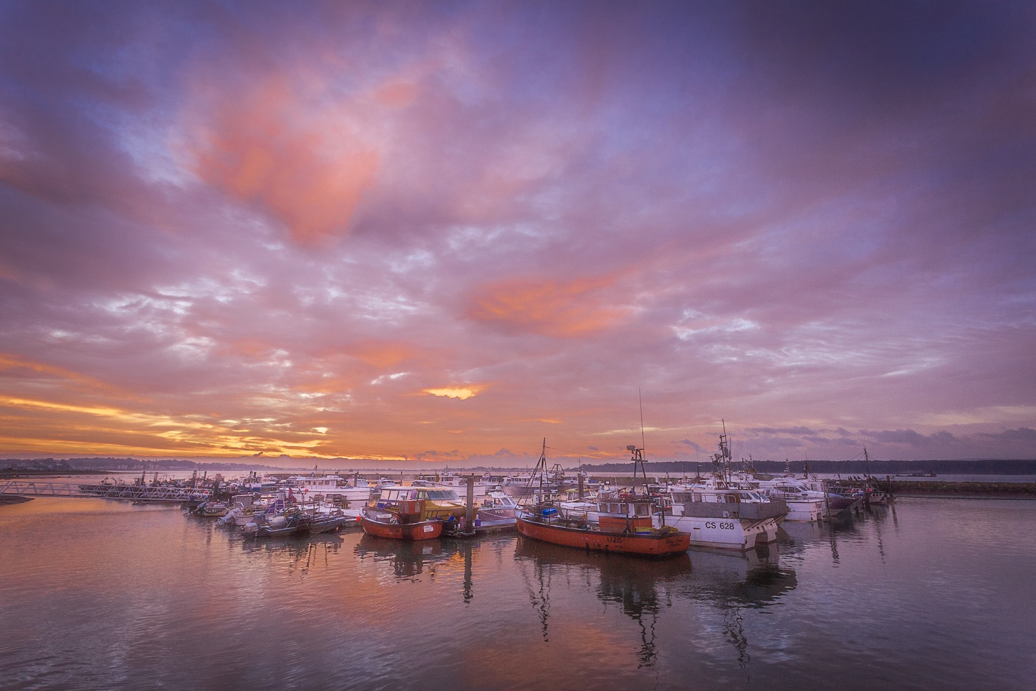 Poole Quay boats at sunrise by Rick McEvoy Photography in Dorset