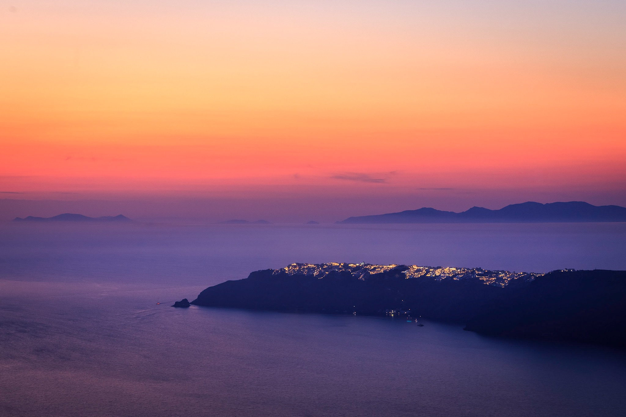 Oia at sunset viewed from Imerovigli - Santorini Photography by Rick McEvoy