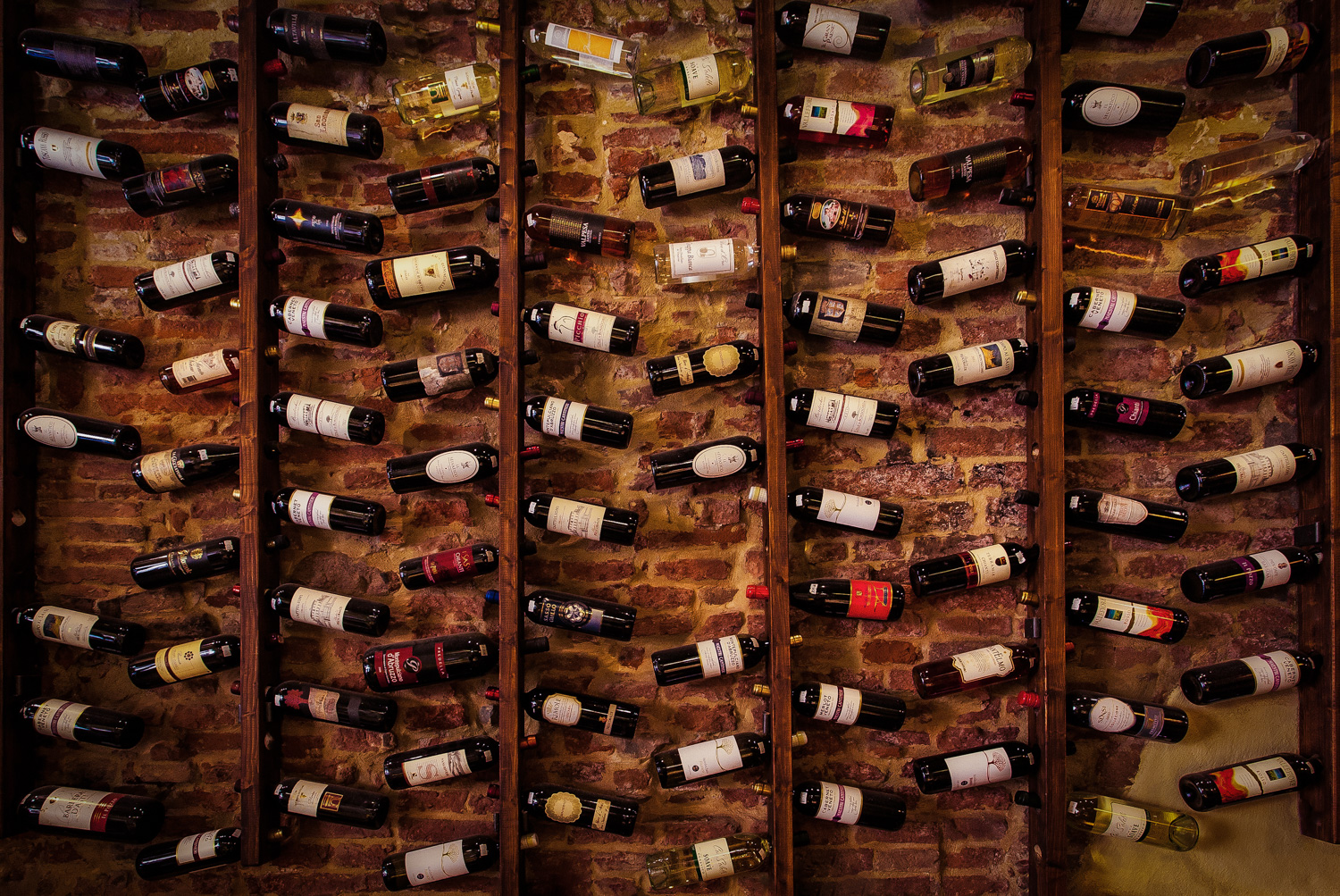 Wine rack on wall in restaurant, Lucca, Italy