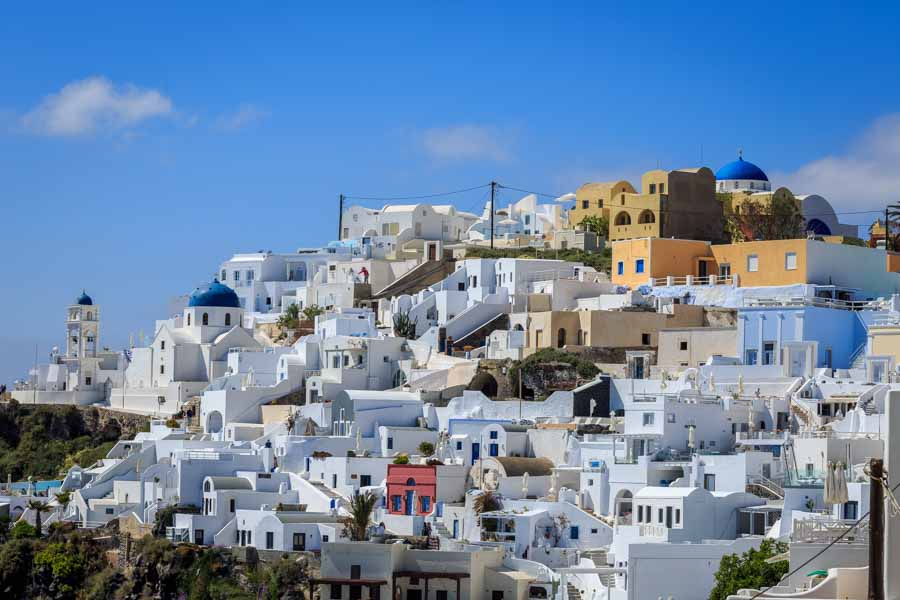 White buildings and blue church roofs on the Greek Island of San