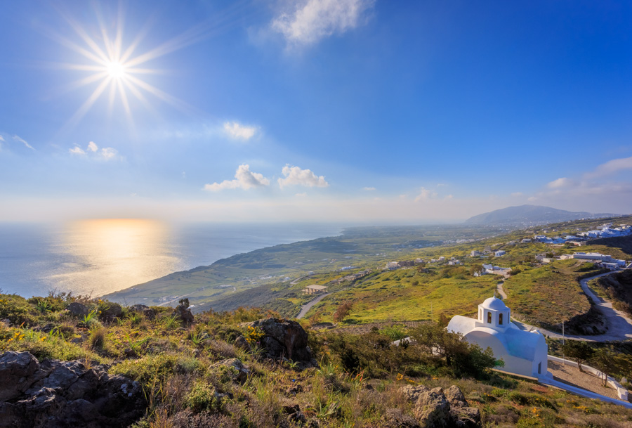 I N Ayiou Mapkou church after sunrise with a spectacular view of the island of Santorini