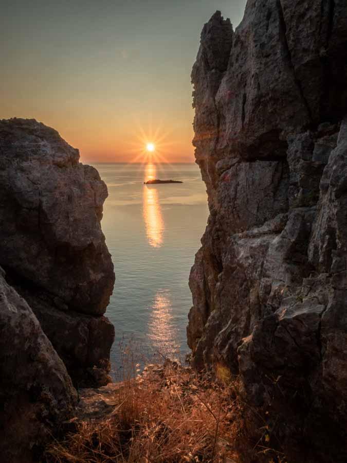 Sunrise through rocks, Rhodes Greece