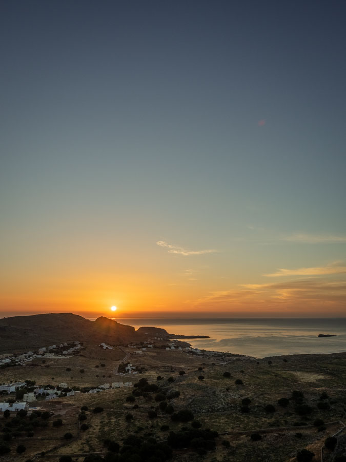Sunrise view with big sky from Pefkos looking towards Lindos
