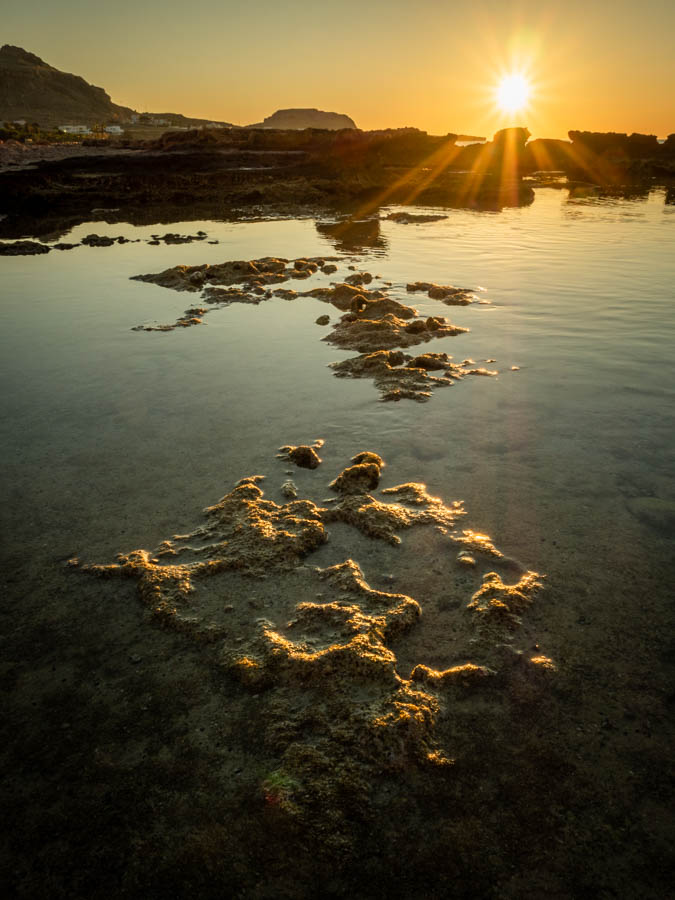 Rock pools at sunrise on Navarone Bay