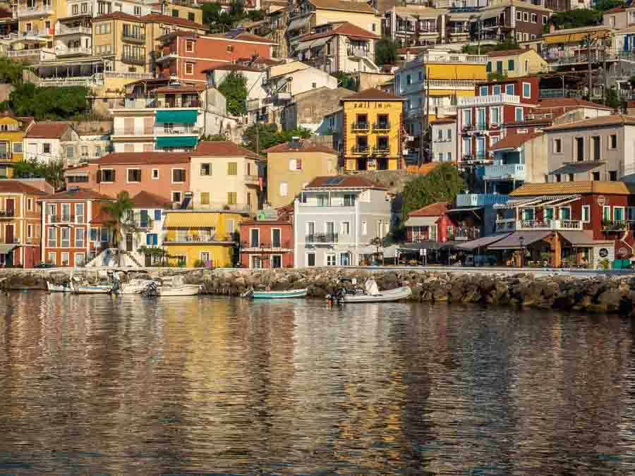 The buildings of Parga at sunrise by Rick McEvoy