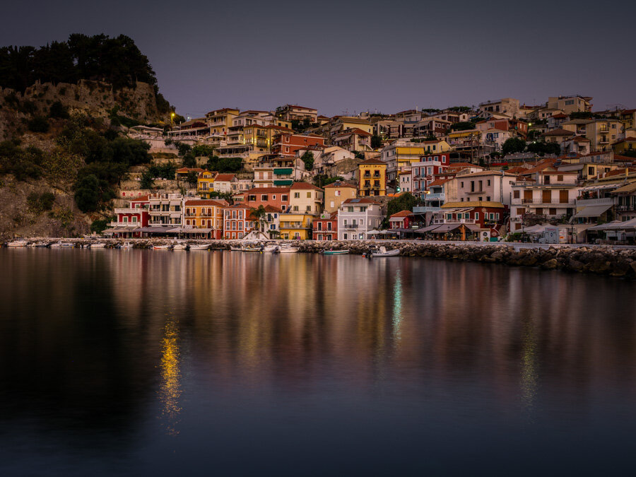 Reflections of the buildings of parga in the early morning light