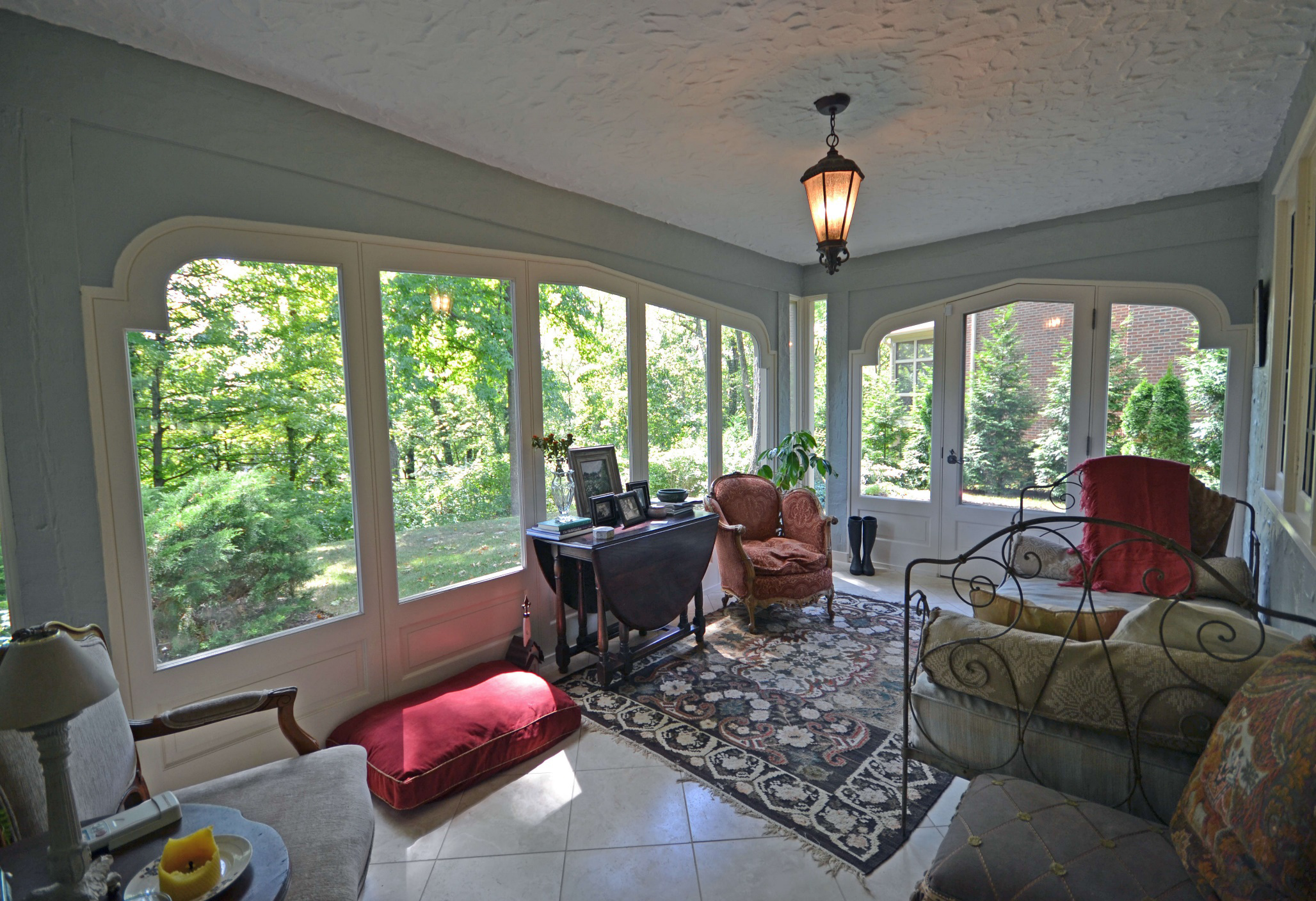 DIGS converted this porch to a four seasons room. Elegant though it is, the process was simpler than you might think. Got a porch you're underutilizing? Hmmmmmm.