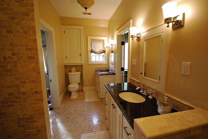 These Hyde Park clients challenged us to make a tiny bathroom master-bath worthy. Splitting the vanities and recessing the toilet were just a couple of the ways we delighted them.