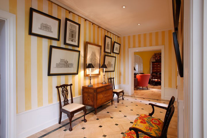 For an extra layer of interest we hung this client's etchings from chains instead of flat on the wall.