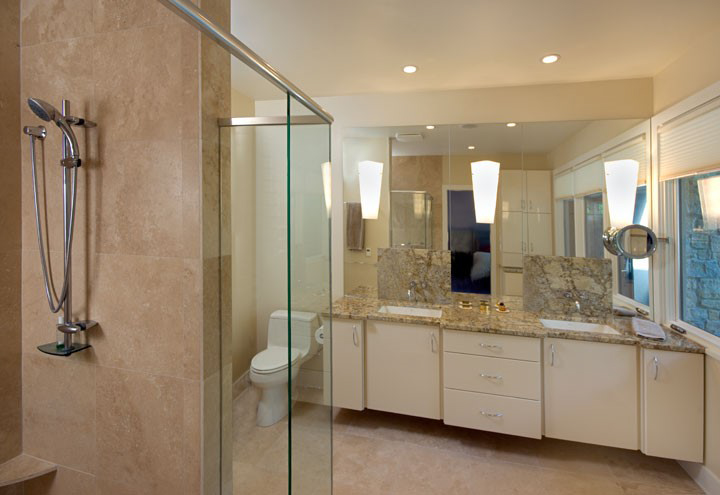 We love mounting lighting over mirrors in bathrooms