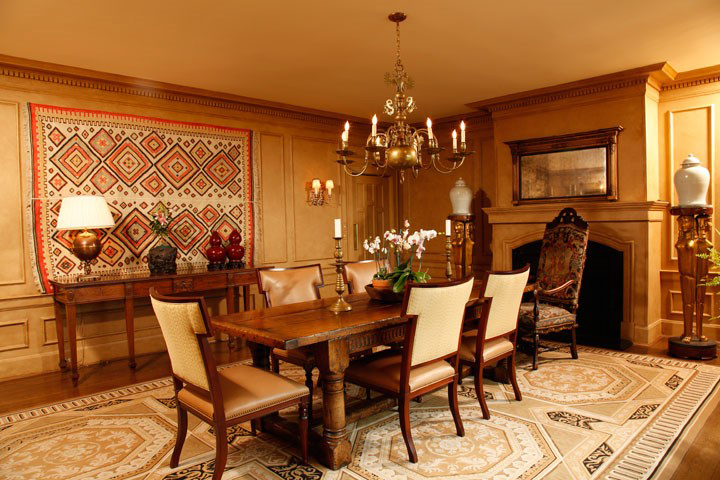 There are two rugs on this room - the floor covering is a Savonnerie rug, topped with rustic trestle table. And on the walls Brian hung an early Kilim rug as art.