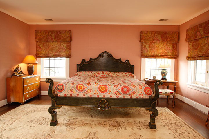A new Michael Taylor bed laid with antique Susani as bedspread perches on the Antique Oushak rug;DIGS' Brian Gibson understands the value rich layers play to create a warm, calm space.