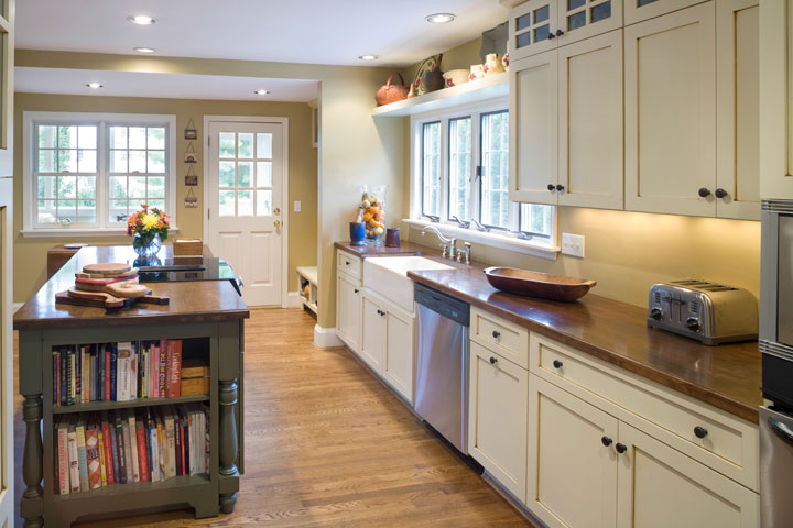 These clients wanted a kitchen that looked like it could have been there all along. Some of the ways we achieved that was by making the island a piece of furniture and topping the counters with very durable Alder wood