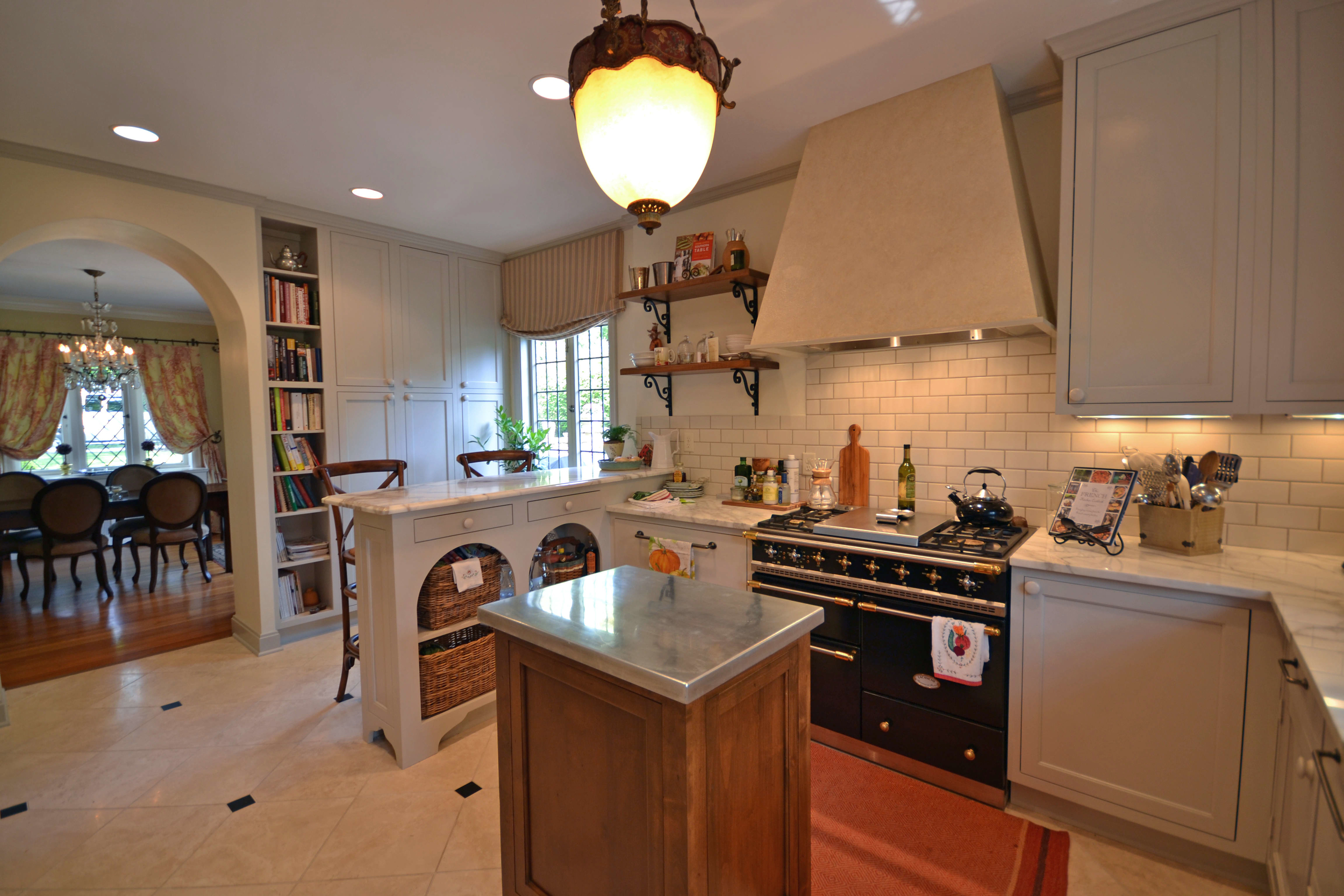 Amongst many of our favorite things in this DIGS' renovated kitchen are the arched basket niches under the peninsula and the La Coucet oven rage imported from France and installed (much to the chagrin of our installer's back muscles) for this gourmet client.