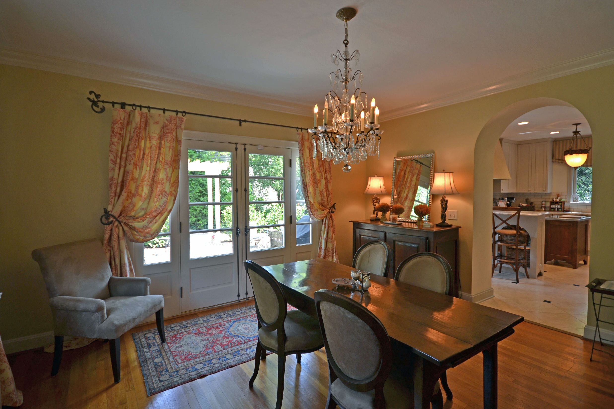 This discerning homeowner wanted to open the dining room to a terrace that did not perviously exist - however the doors had to evoke the tradition of this home.
