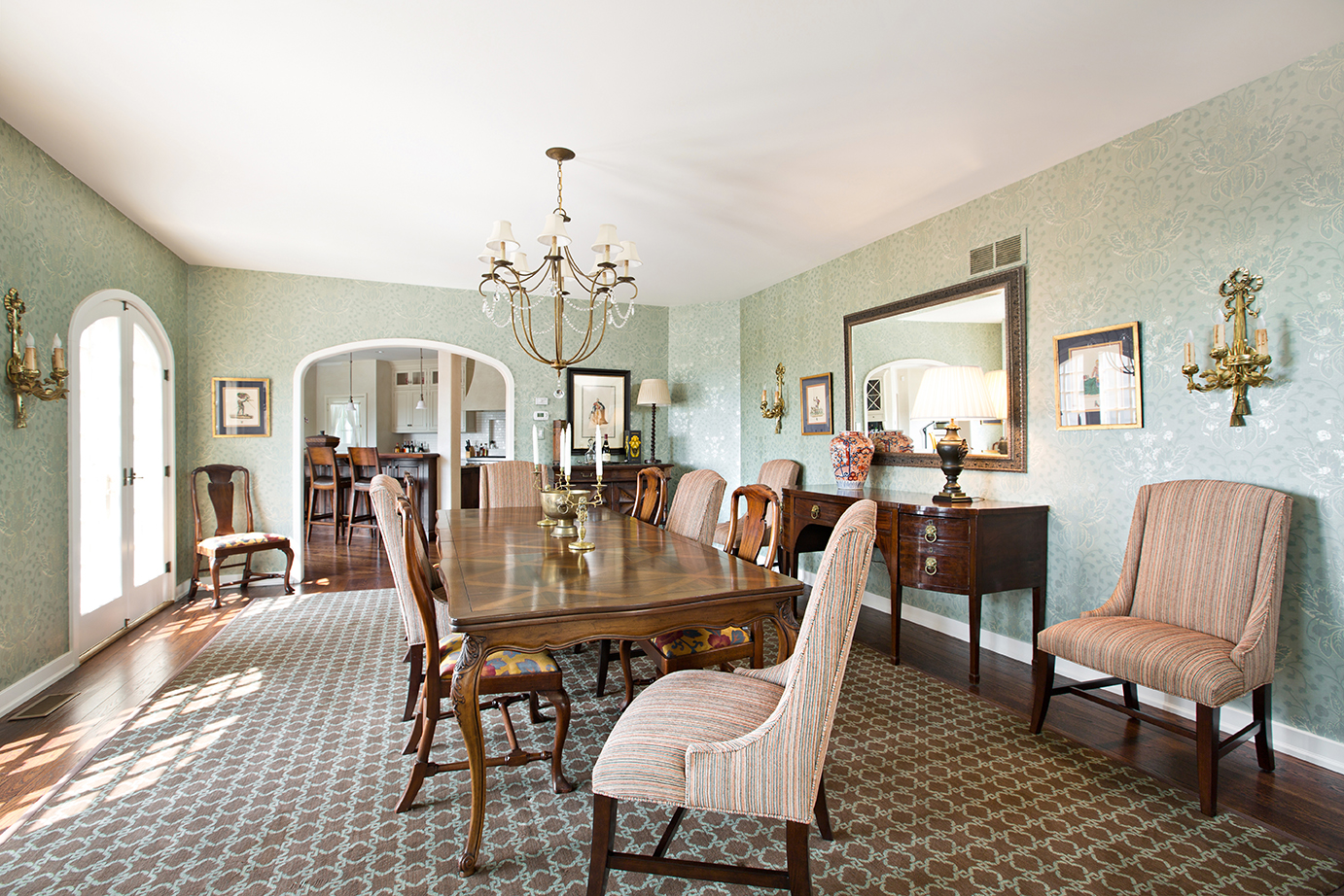 Another example of how a serious dining room doesn't have to take itself so seriously. We dig mixing and matching dining room chairs.