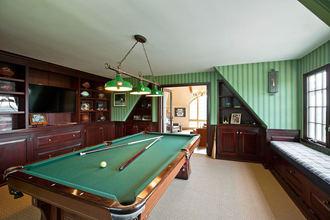 In this client's billiards room - we measure cue-age before finalizing renovation plans. The devil's in the details