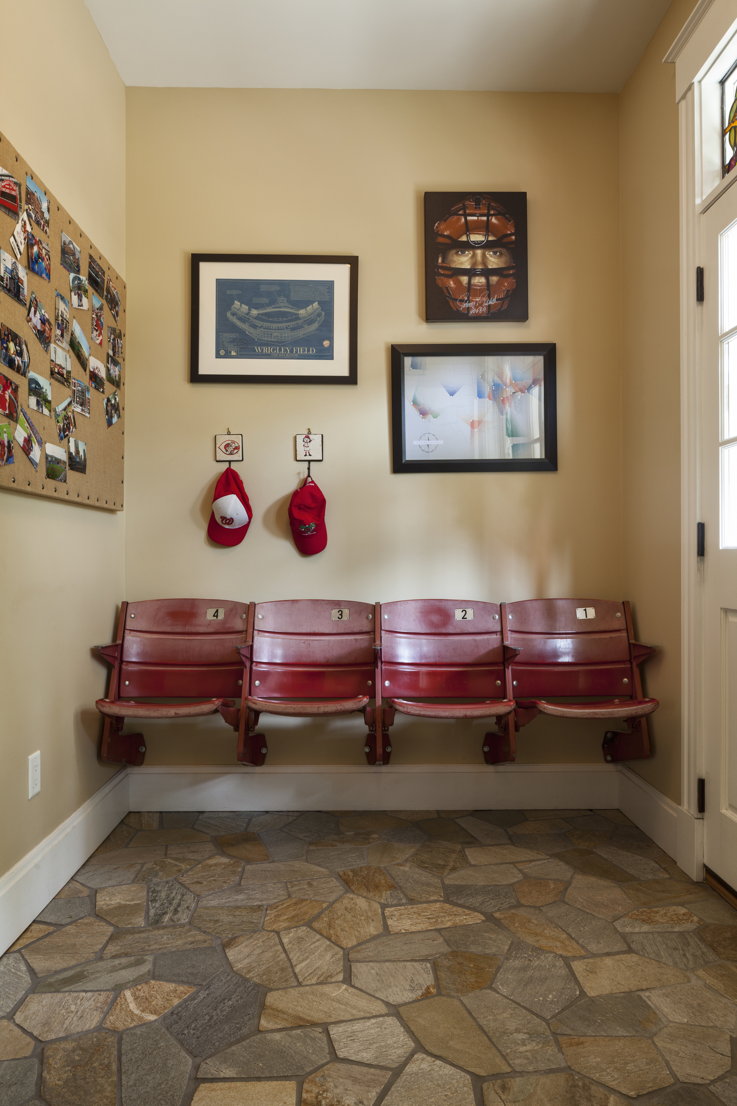 Rounding the corner and sliding into home, these baseball-loving clients asked us to incorporate their salvaged riverfront stadium seats into their renovation project. Our solution - what better place to strap on your boots in the mud room.