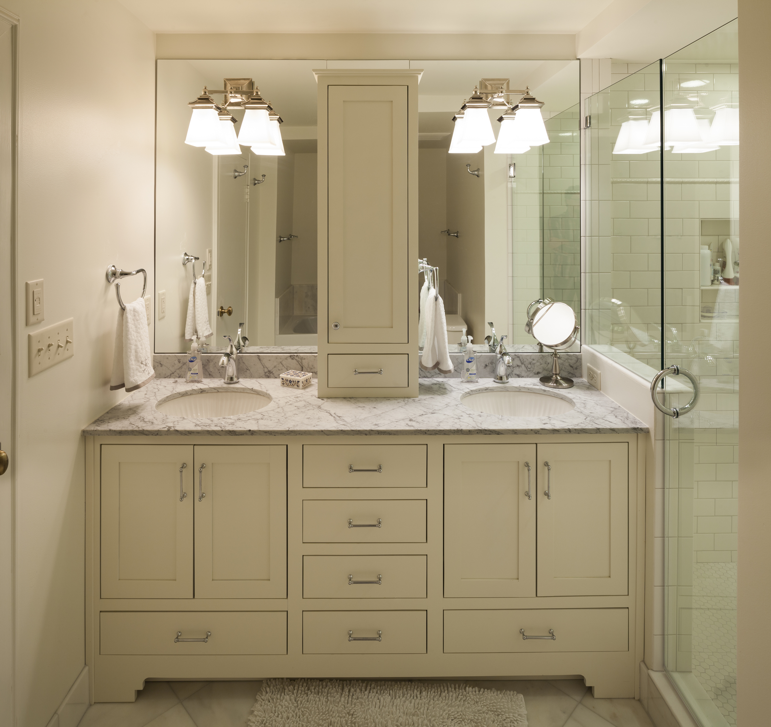 Dual sinks save marriages. Note: DIGS is obsessed with making vanities look like furniture and we almost always include bottom drawers that avoid plumbing impedimentsperfect for storing toilet paper.